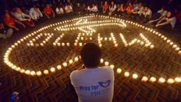 Chinese relatives of passengers on the missing Malaysia Airlines flight MH370 take part in a prayer service at the Metro Park Hotel in Beijing.