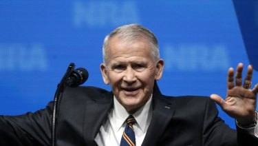 Oliver North acknowledges at the National Rifle Association-Institute for Legislative Action Leadership Forum in Dallas.