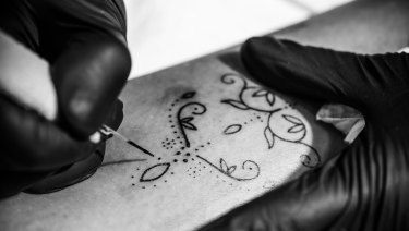 8859990f8 Tattoo artist Amy Unalome uses a hand-poke technique to create delicate  designs.