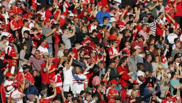 Lions fans celebrate a try during a Super Rugby semi-final match between the Lions and the Highlanders at Ellis Park in 2016.