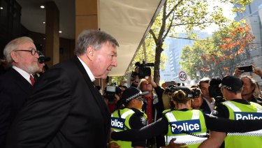 Cardinal Pell leaves the court with lawyer Robert Richter, QC.