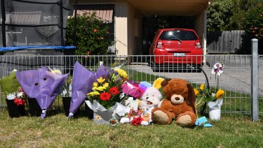Flowers and teddies left outside the Alma Street property in Tootgarook on Friday.