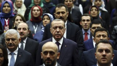 The regime of Turkish President Recep Tayyip Erdogan, center, has jailed thousands of people accused of being plants for Fethullah Gulen.