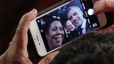 Macron stops to take a selfie with Texas Democrat Sheila Jackson Lee, after addressing the US Congress.