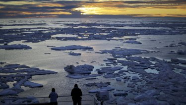 Diminishing Arctic ice: researchers look out from the Finnish icebreaker MSV Nordica as the sun sets over sea ice in the Victoria Strait along the Northwest Passage in the Canadian Arctic Archipelago in July 2017.