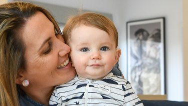 Libby Nuttall and her six-month-old son Elliott. She is one of many women who have private health cover but have opted to use the public system instead to give birth.