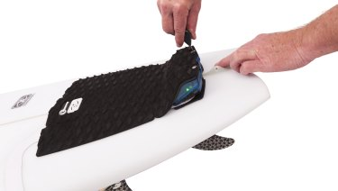 The Shark Shield product on a surf board.