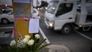 Louis Datoi placed flowers and a note at the scene.
