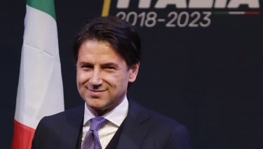 Giuseppe Conte smiles during a meeting in Rome.