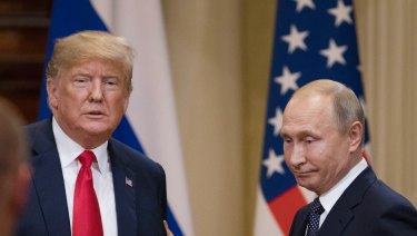Donald Trump, left, and Vladimir Putin prepare to leave following a news conference in Helsinki.