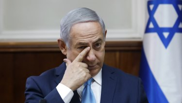 Israeli Prime Minister Benjamin Netanyahu chairs the weekly cabinet meeting at the Prime Minister's office in Jerusalem on Sunday.