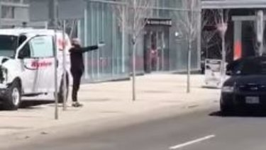 A lone police officer confronted Minassian, who appeared to be pointing a gun.