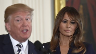 US President Donald Trump speaks while first lady Melania Trump listens earlier this month.