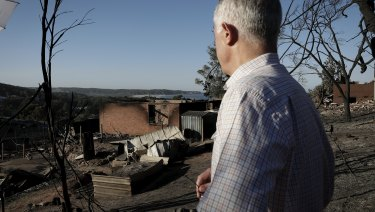 Malcolm Turnbull visit burned out homes in Tathra on Monday.