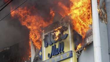 A fire rages on at a shopping mall.