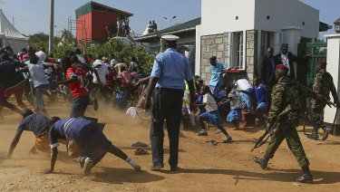 Police chase Kogelo residents away during Obama's visit on Monday.