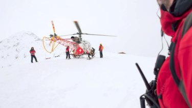 Swiss authorities' rescue helicopter in Alps.