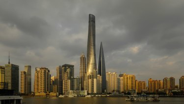 The Shanghai Tower, centre, one of the world's tallest, greenest buildings.