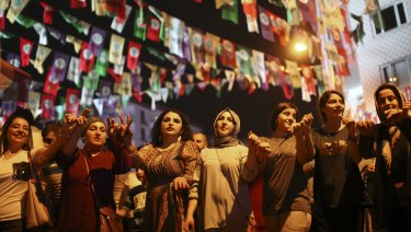 Women dance under election banners of the pro-Kurdish Peoples' Democratic Party, or HDP, in the mainly-Kurdish city of Diyarbakir.