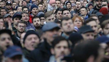 People celebrate the resignation of Prime Minister Robert Fico in Bratislava, Slovakia.