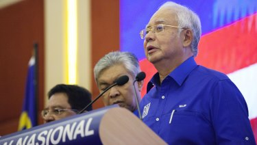 Najib Razak, Malaysia's outgoing prime minister, right, speaks during a news conference at the Barisan Nasional coalition headquarters in Kuala Lumpur, Malaysia, on Thursday.