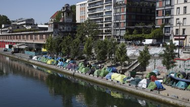 Tents where asylum seekers live are packed alongside of the canal Saint-Martin in Paris.