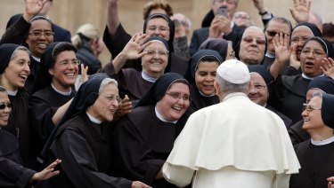 Pope Francis meets a group of Franciscan nuns