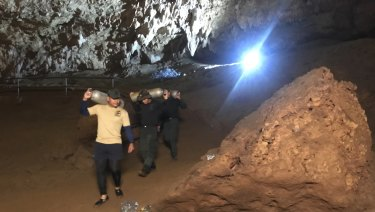 Rescue workers continue to search for a group of missing boys and their coach in a flooded cave in Thailand.