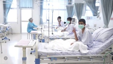 In this image made from video, released by the Thailand Government Spokesman Bureau, three of the 12 boys are seen recovering in their hospital beds after being rescued.