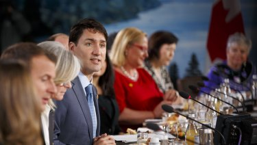 Justin Trudeau, Canada's prime minister, centre, speaks during the Group of Seven.