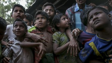 Rohingya refugees gather to receive relief supplies donated in the Leda Rohingya refugee camp in Chittagong, Bangladesh.
