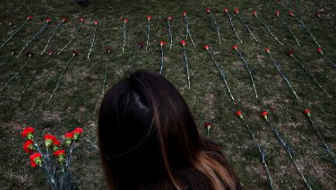 An activist places flowers on the West Front of the Capitol that they said are to memorialise children killed by Saudi bombings in Yemen, in Washington in March.