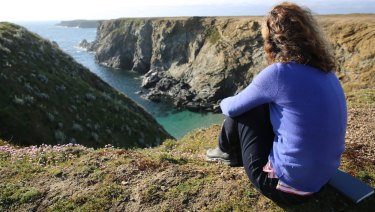Sarah Turnbull, on Belle Ile, looks out over the Cote Sauvage.