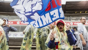 Western Bulldogs supporters donned plastic ponchos as the rain came down.