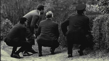 Police keep a close watch on the Glenfield house on July 3, 1968