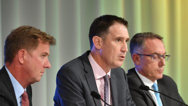 Done deal: Cricket Australia chief James Sutherland (centre) with Seven's Tim Worner and Foxtel's Patrick Delaney.