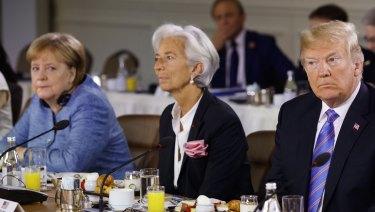 Angela Merkel, IMF chief Christine Lagarde and Donald Trump