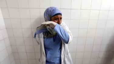 A colleague of Palestinian Razan Al-Najar reacts after hearing of the 21-year-old nurse's death.