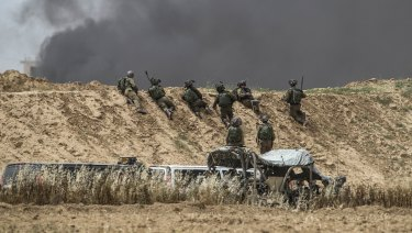 Israeli soldiers take position during protests along Israel Gaza border last month.