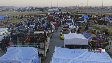 People who fled Daraa in their won vehicles gathering near the Syria-Jordan border.