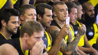 In the frame for another flag: Dustin Martin keens an eye on Alex Rance's selfie.