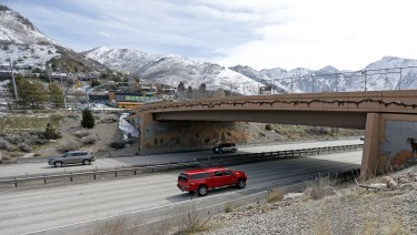 Vehicles pass under a bridge in Salt Lake City. Utah is the nation's biggest proponents and user of the bridge construction method that was used in the Florida bridge that collapsed.