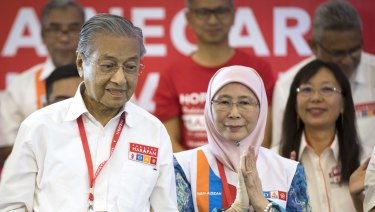 Unlikely alliance: Former prime minister Mahathir Mohamad at a rally in Shah Alam, Malaysia, earlier this month, with opposition leader Wan Azizah Wan Ismail.