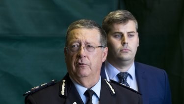 Police Commissioner Ian Stewart and Police Minister Mark Ryan speak to reporters about more than 800 illegal firearms seized this month.