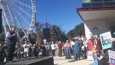 Veteran journalist Tony Koch address the rally outside the South Bank ABC studios.
