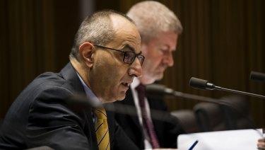 Secretary of the Department of Home Affairs, Michael Pezzullo, and senator Mitch Fifield during Senate estimates.