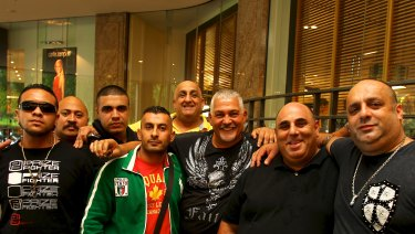 'Little' Al Taouil in green jacket with Mick Gatto and others in 2012. The men are not accused of any wrongdoing.