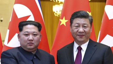 North Korean leader Kim Jong-un, left, and Chinese President Xi Jinping shake hands in Beijing, China.