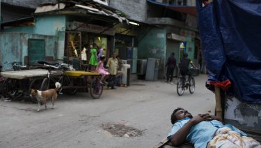 A man sleeps on a cart at Mohammadpur Geneva camp where over 100 suspected drug peddlers were detained in a raid last week.