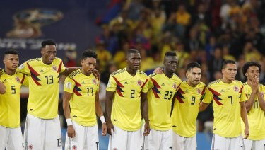 Colombia's players watch on during the penalty shootout against England.
